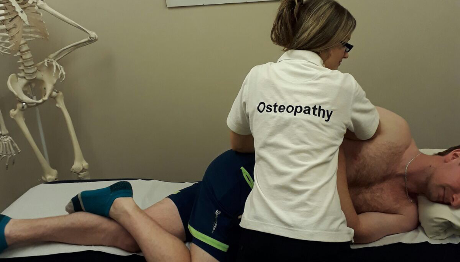 Physiotherapist performing a back massage