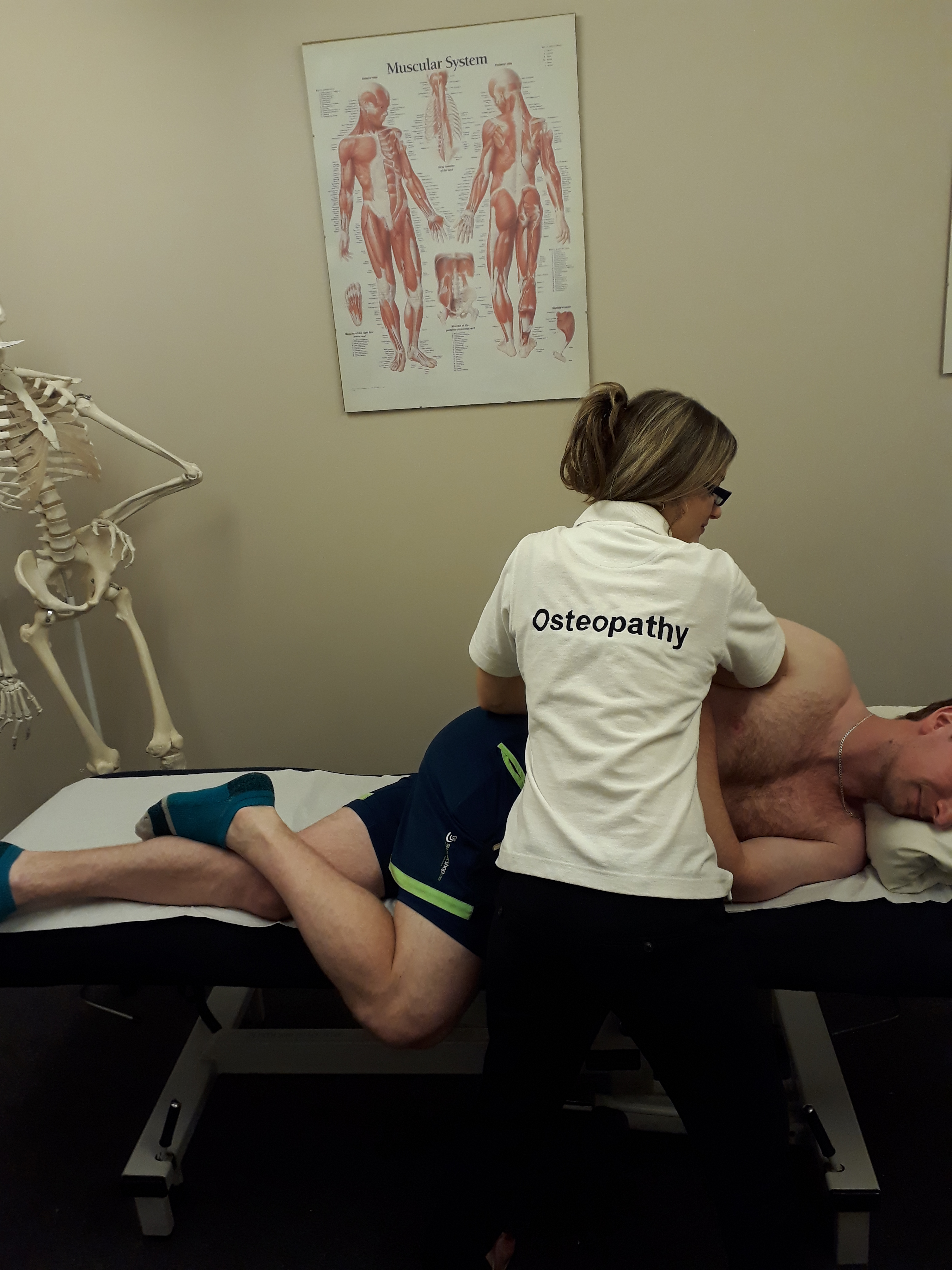 Physiotherapist examining a patients injured back