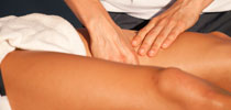 Physiotherapist performing a leg massage